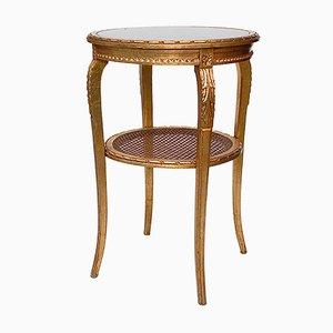 Tavolino rotondo vintage dorato con ripiano in canna