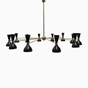 Lámpara de araña italiana de latón y metal negro de Stilnovo, años 50