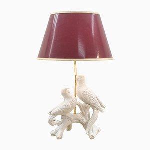 Lámpara de mesa de cerámica blanca con dos loros, años 60