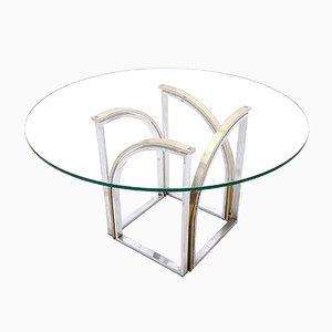 Mesa de comedor redonda de latón, vidrio y acero de Romeo Rega, años 70