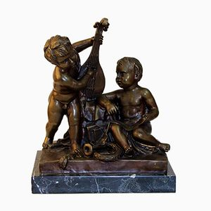 Antique Figurine of Kids Playing Banjo by Jean-Baptiste Pigalle