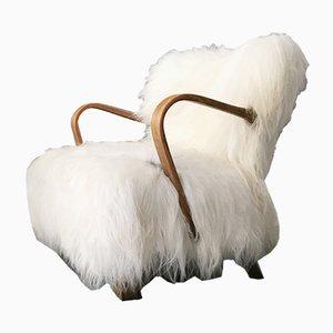 Butaca WH237 vintage de madera curvada con piel de oveja de Jindřich Halabala