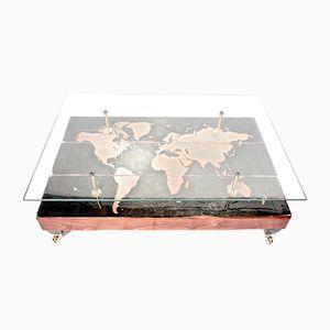 Tavolino con antica mappa del mondo di Cappa E Spada, 2015