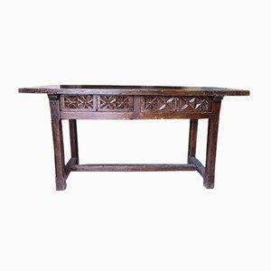 Tavolo in legno massiccio intagliato, inizio XX secolo