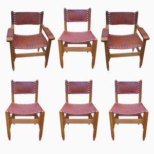 Butacas y sillas vintage de cuero y madera. Juego de 6