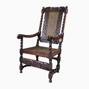 Geschnitzter antiker Armlehnstuhl aus Eiche