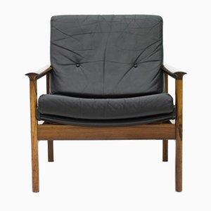 Poltrona escandinava de palisandro y cuero negro, años 60