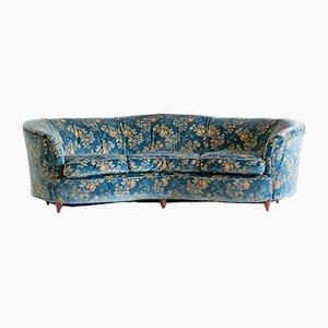 Großes geschwungenes Sofa mit blauem Bezug mit Blumen-Motiven, 1930er