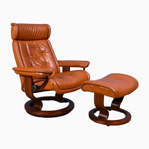 Mid-Century Norwegian Leather Swivel Recliner & Footstool from Ekornes