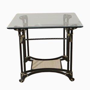 Mesa auxiliar vintage con elementos dorados