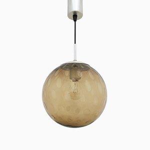 Lampada a sospensione sferica in vetro fumé di Raak, anni '70
