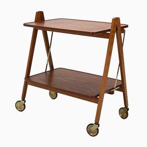 Mesa auxiliar plegable de teca con ruedas, años 50