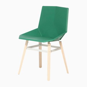 Silla verde con patas de madera de Mobles114