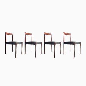 Sillas de comedor vintage de palisandro con asientos de cuero negro de Lübke. Juego de 4