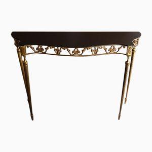 Mesa consola pequeña de vidrio negro y latón