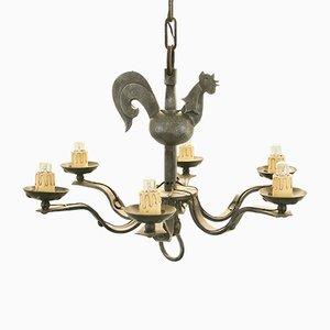 Lámpara de araña Mid-Century de hierro forjado de Jean Touret para Atelier Marolles, años 50