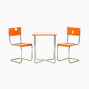 Mesa vintage y dos sillas de Mucke Melder, años 40