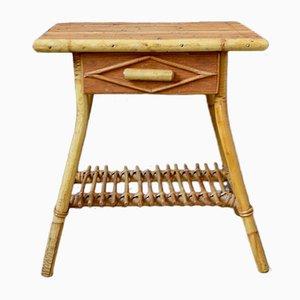 Mesa bohemia vintage de ratán con pedestal