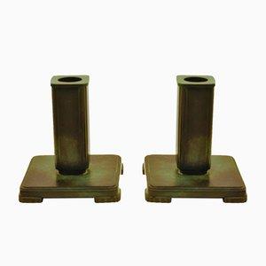 Candeleros de bronce patinado de G.A.B., años 30. Juego de 2