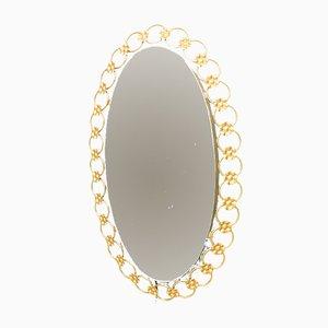 Specchio ovale con luce ed anelli in metallo dorato, anni '50