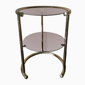 Mesa auxiliar vintage de metal tubular dorado y cristal ahumado