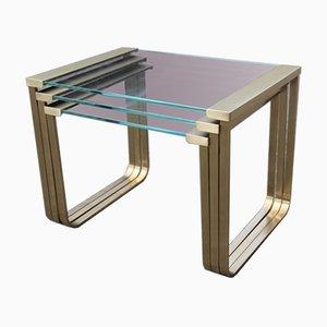 Mesas de centro apilables italianas de latón satinado y vidrio, años 70