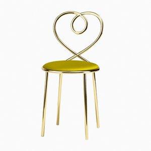 Silla Love en amarillo anís de N. Zupanc para Ghidini 1961