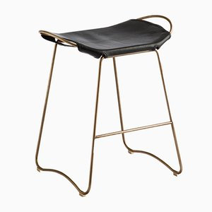 Aged Brass Steel & Black Vegetable Tanned Leather Hug Counter Stool by Jover+Valls
