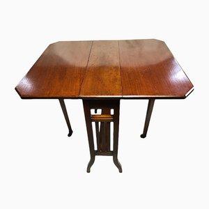 Mesa extensible antigua de nogal