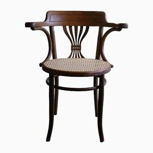 Vintage Armlehnstuhl mit Sitz aus Schilfrohr von Fischel, 1910er