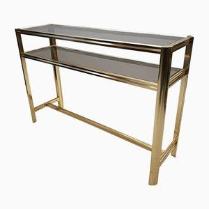 Mesa auxiliar vintage de metal dorado y vidrio ahumado, años 80