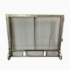 Protector de chimenea vintage de metal con cota de malla