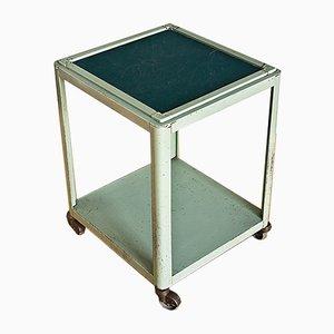 Mesa auxiliar vintage de metal lacado con ruedas, años 60