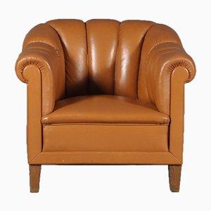 Club chair in pelle color cognac, Italia, anni '80
