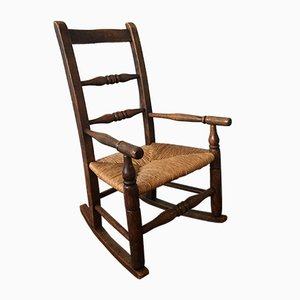 Sedia a dondolo da bambino antica in quercia