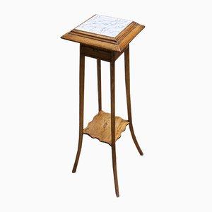 Tavolino vintage in legno e ceramica