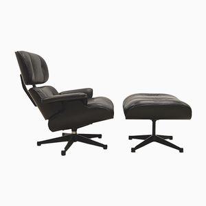 Schwarzer Sessel & Fußhocker von Charles & Ray Eames für Vitra, 1980er