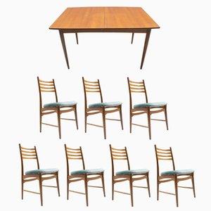 Mesa de comedor extensible de teca con siete sillas, años 60
