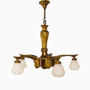 Lampadario Art Deco in bronzo dorato e legno