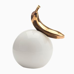 Gold Banana on a White Ball Sculpture from StudioKahn