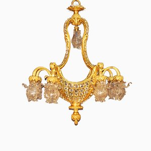 Lámpara de araña de bronce dorado y cristal, siglo XIX