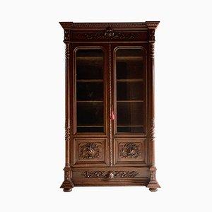 Vetrina antica in legno di quercia intagliato, fine XIX secolo