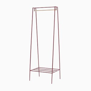 A Clothes Rail in Beetroot with a Brass Pole by &New