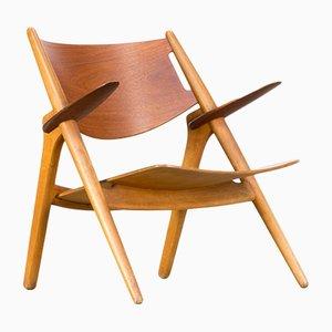 Chaise longue CH28T di Hans J. Wegner per Carl Hansen & Son, anni '60