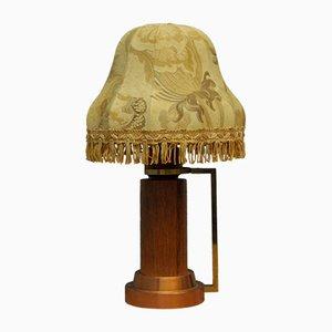 Lámpara de mesa danesa de teca y cobre, años 60