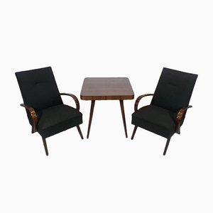 Tavolino da caffè e due poltrone di Jindřich Halabala per UP Závody, anni '50