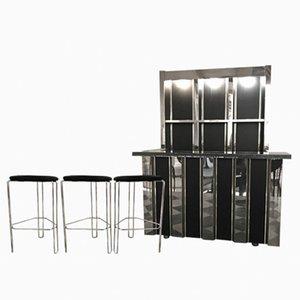 Mueble bar y tres taburetes de Romeo Rega, años 70