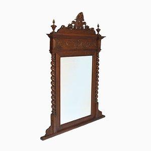 Specchio da consolle o camino antico rinascimentale in legno di noce tornito ed intagliato a mano di Ballario, Italia