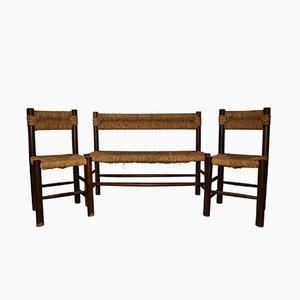 Banco y dos sillas de madera y ratán de Charlotte Perriand, años 70