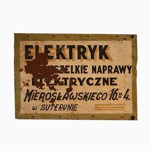Insegna pubblicitaria vintage di un negozio di riparazioni, Polonia